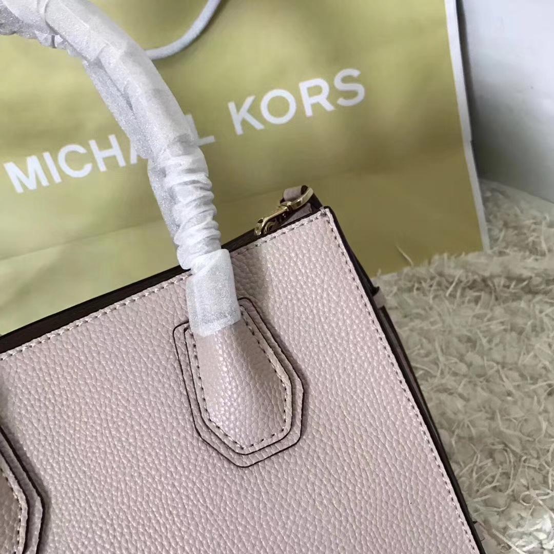 MK Mercer手袋 最新穿孔款镂空荔枝纹牛皮手提包单肩斜挎包 粉色